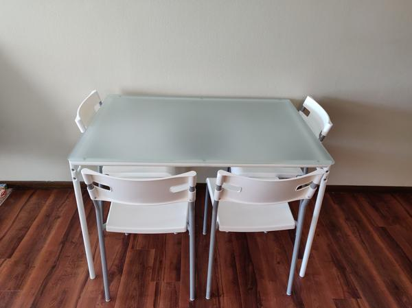 Ikea Glass-top Dining Table With Four Chairs